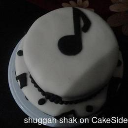 Thumb musical notes cake